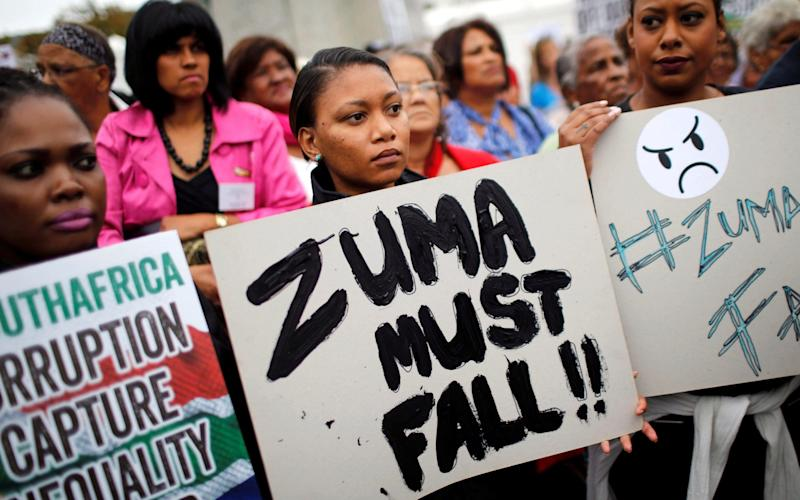 Demonstrators protest against South African President Jacob Zuma's firing of his finance minister on Friday - REUTERS
