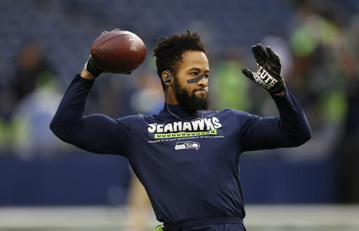 "FILE - In this Nov. 20, 2017, file photo, Seattle Seahawks' Earl Thomas warms up before an NFL football game against the Atlanta Falcons, in Seattle. Seahawks safety Earl Thomas appears set to end his lengthy holdout in time for the start of the regular season, even without a new contract. Thomas posted to Instagram on Wednesday morning, Sept. 5, 2018. saying he's never let his ""teammates, city or fans down as long as I have lived and don't plan to start this weekend.""(AP Photo/Stephen Brashear, File)"