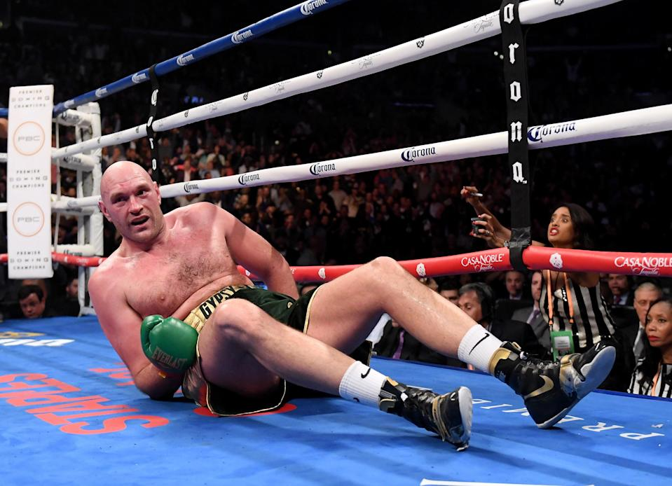 Tyson Fury somehow gets up during the WBC Heavyweight Champioinship at Staples Center. Pic: Getty