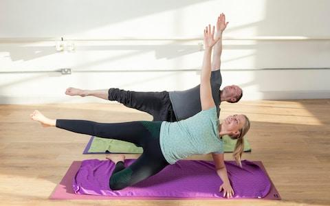The Telegraph's Maddi Howell trying out hot pilates with head instructor Lee Hopkins at Fitness Fusions, Clapham - Credit: Geoff Pugh
