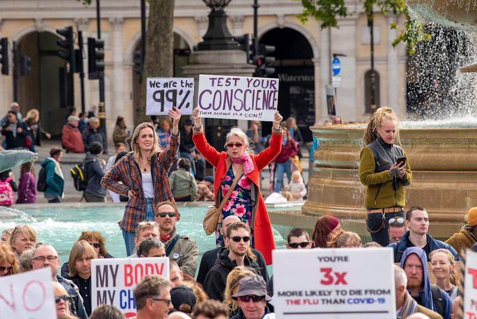 <strong>Protesters holding placards expressing their opinion during the We Do Not Consent protests in Trafalgar Square London against Lockdown last year.</strong> (Photo: SOPA Images via Getty Images)