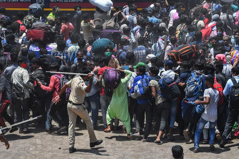 Police disperse migrant workers trying to board a special train