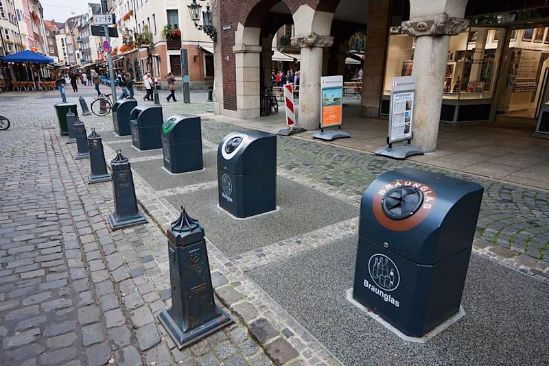 Recycling bins shown here in Dusseldorf are ubiquitous in Germany (Photo by: Insights/UIG via Getty Images)
