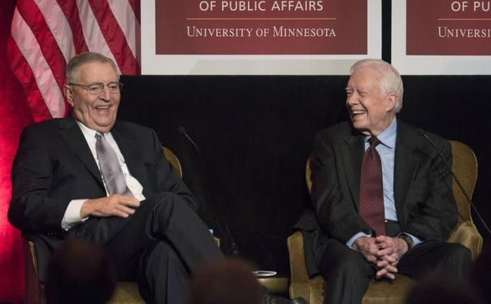 FILE PHOTO: Former U.S. President Jimmy Carter laughs with former U.S. Vice President Walter Mondale in Washington