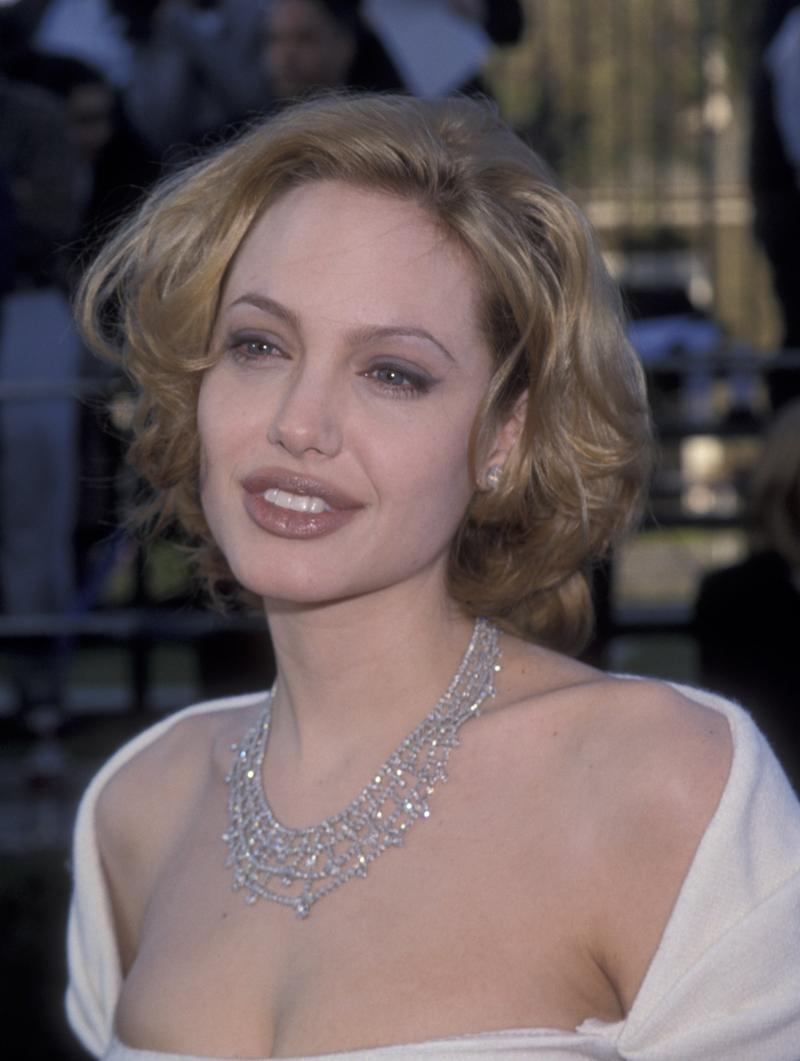 Going blonde for the actress turned out to be a temporary affair. Angelina Jolie at the Screen Actors Guild awards in Los Angeles, California, March 1999. Photo by Getty Images.
