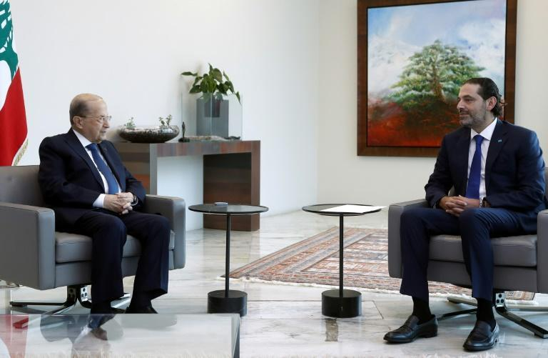 A handout picture provided by the Lebanese photo agency Dalati and Nohra on July 15, 2021, shows Lebanon's prime minister-designate Saad Hariri meeting with President Michel Aoun at the presidential palace in Baabda, east of the capital Beirut