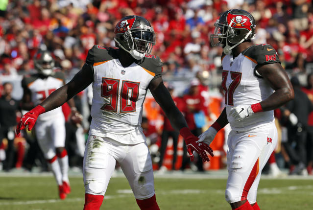 FILE - In this Sunday, Nov. 25, 2018, file photo, Tampa Bay Buccaneers defensive ends Jason Pierre-Paul (90) and Vinny Curry (97) react during the first half of an NFL football game against the San Francisco 49ers in Tampa, Fla. Pierre-Paul insists he doesnt have anything to prove in his first season with the Buccaneers. Hes been the best player on a largely disappointing defense, but says hes just doing his job. (AP Photo/Mark LoMoglio, File)