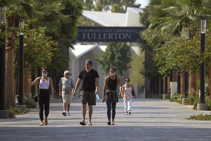 New student Olivia Murphy, 20, left in white top, takes her family on a tour of Cal State Fullerton in August.