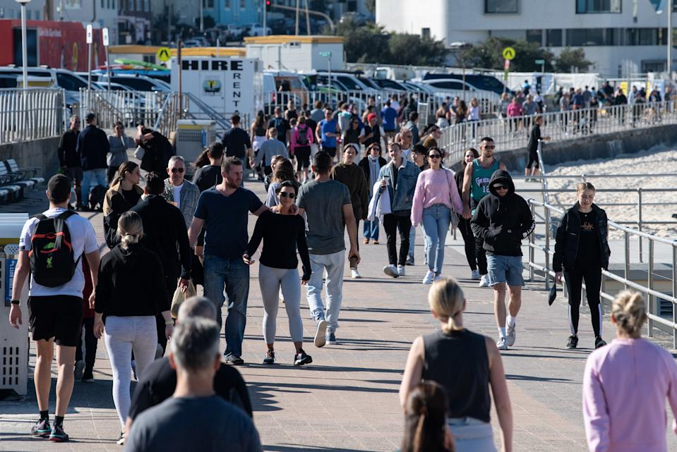 People walking along the sea front at Bondi Beach in Sydney, Saturday, June 6, 2020. Coronavirus restrictions are slowly being eased across Australia with states and territories at different stages on the roadmap to reopen the nation.