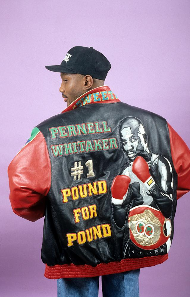 Pernell Whitaker poses with his jacket during a portrait session in New York. (Photo by: The Ring Magazine via Getty Images)