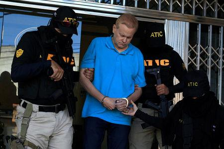 Agents of the Technical Criminal Investigation Agency (ATIC) escort Kentucky attorney Eric Christopher Conn, 57, wanted by the FBI over his role in a disability fraud scheme, in Tegucigalpa, Honduras December 5, 2017. REUTERS/Jorge Cabrera