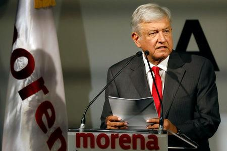 Mexican presidential candidate Andres Manuel Lopez Obrador of the National Regeneration Movement (MORENA) reacts during the presentation of his shadow cabinet for the July 2018 presidential election, in Mexico City, Mexico December 14, 2017. Picture taken December 14, 2017. REUTERS/Edgard Garrido