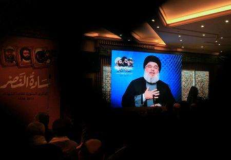 File photo: Lebanon's Hezbollah leader Sayyed Hassan Nasrallah addresses his supporters through a screen during a rally commemorating the annual Hezbollah Martyrs' Leaders Day in Jebshit village