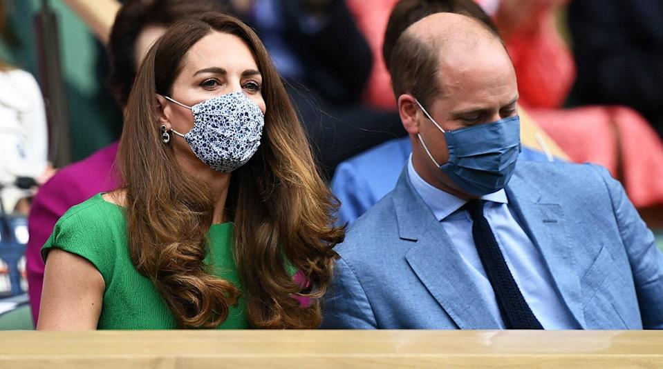 Britain's Catherine, Duchess of Cambridge and Britain's Prince William, Duke of Cambridge, wearing face masks, take their sets in the Royal box to watch the women's singles final on the twelfth day of the 2021 Wimbledon Championships at The All England Tennis Club in Wimbledon, southwest London, on July 10, 2021.