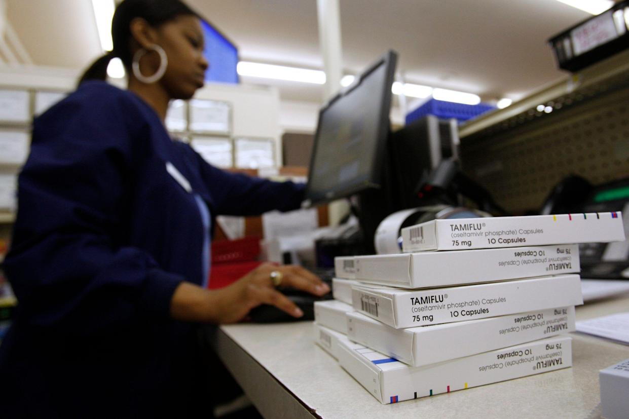 A pharmacist fills orders at Doughery's Pharmacy in Dallas. (Photo: Jessica Rinaldi/Reuters)