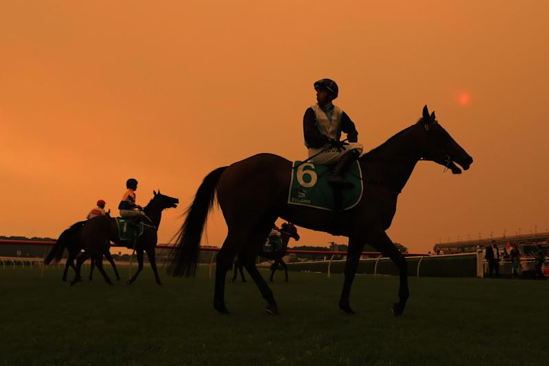 Smoke from the Sydney bushfires turns the sky above a racecourse orange. (Photo: Mark Evans via Getty Images)