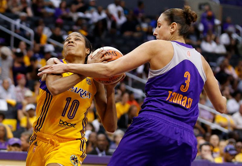 Los Angeles Sparks' Lindsey Harding, left, draws a foul from Phoenix Mercury's Diana Taurasi, right, while heading for the baseket during the first half in Game 1 of their WNBA basketball Western Conference semifinal series on Thursday, Sept. 19, 2013, in Los Angeles. (AP Photo/Danny Moloshok)