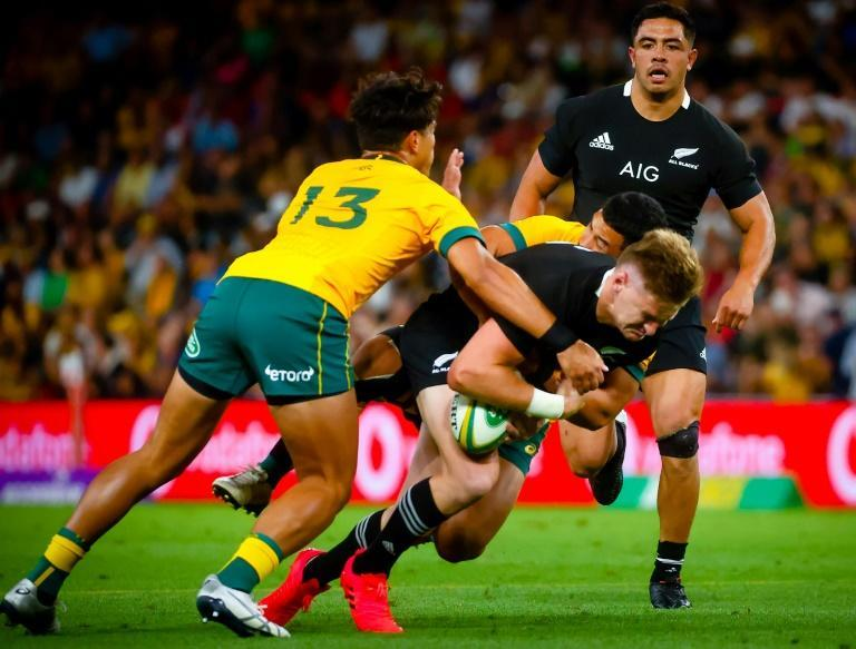 "Jordan Petaia (13) tackles Beauden Barrett. ""We know that players don't go out with the intent to take people's heads off... when you've got 125kg that commits to a target, it's very difficult to change,"" says former Wallaby Justin Harrison"