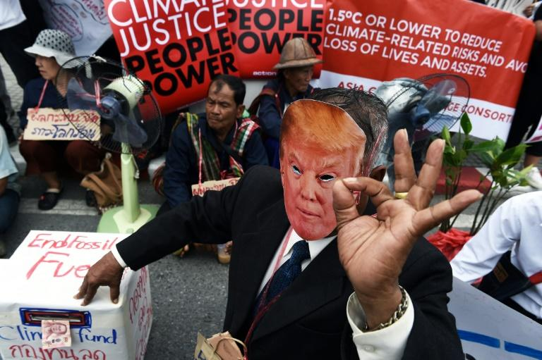 Climate deniers have garnered far more media attention than prominent climate scientists over the years, fuelling public confusion and a slow response to global warming (AFP Photo/LILLIAN SUWANRUMPHA                 )