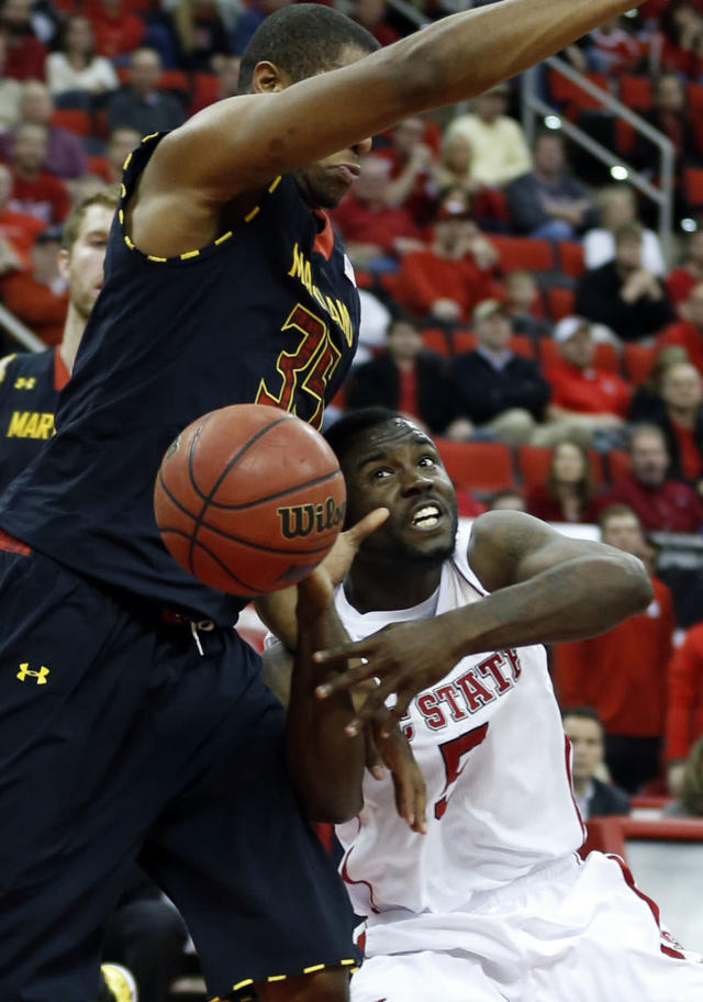 N.C. State's Desmond Lee (5) loses control of the ball as he runs into Maryland's Damonte Dodd (35) during the first half of N.C. State's game against Maryland at PNC Arena in Raleigh, N.C. Monday, Jan. 20, 2014. (AP Photo/The News & Observer, Ethan Hyman)