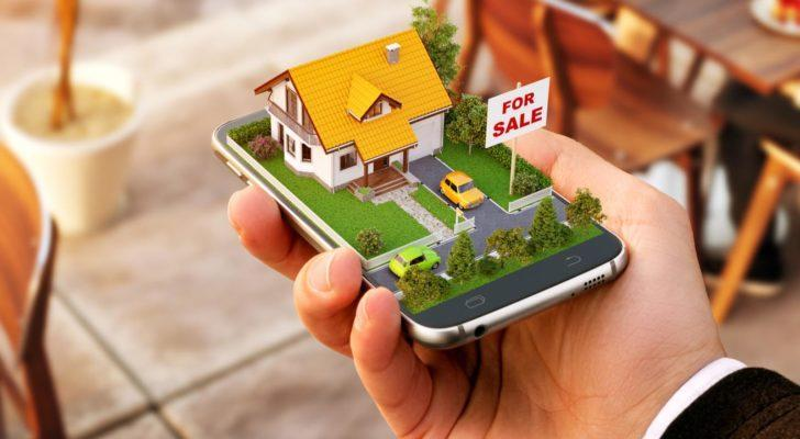 """An illustration of a miniature house with a """"for sale"""" sign popping out of a smartphone."""
