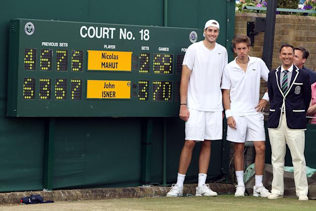"<p class=""MsoNormal""><span>The marathon game: John Isner vs. Nicolas Mahut. In <b>2010</b>, Wimbledon witnessed the longest-ever tennis match, lasting just over 11 hours over the course of three days. Isner won the final set (70-68) to prevail, but both players would go down in history for sharing a record that may never be broken.</span></p><p class=""MsoNormal"">(Photos: Getty Images)<br></p>"