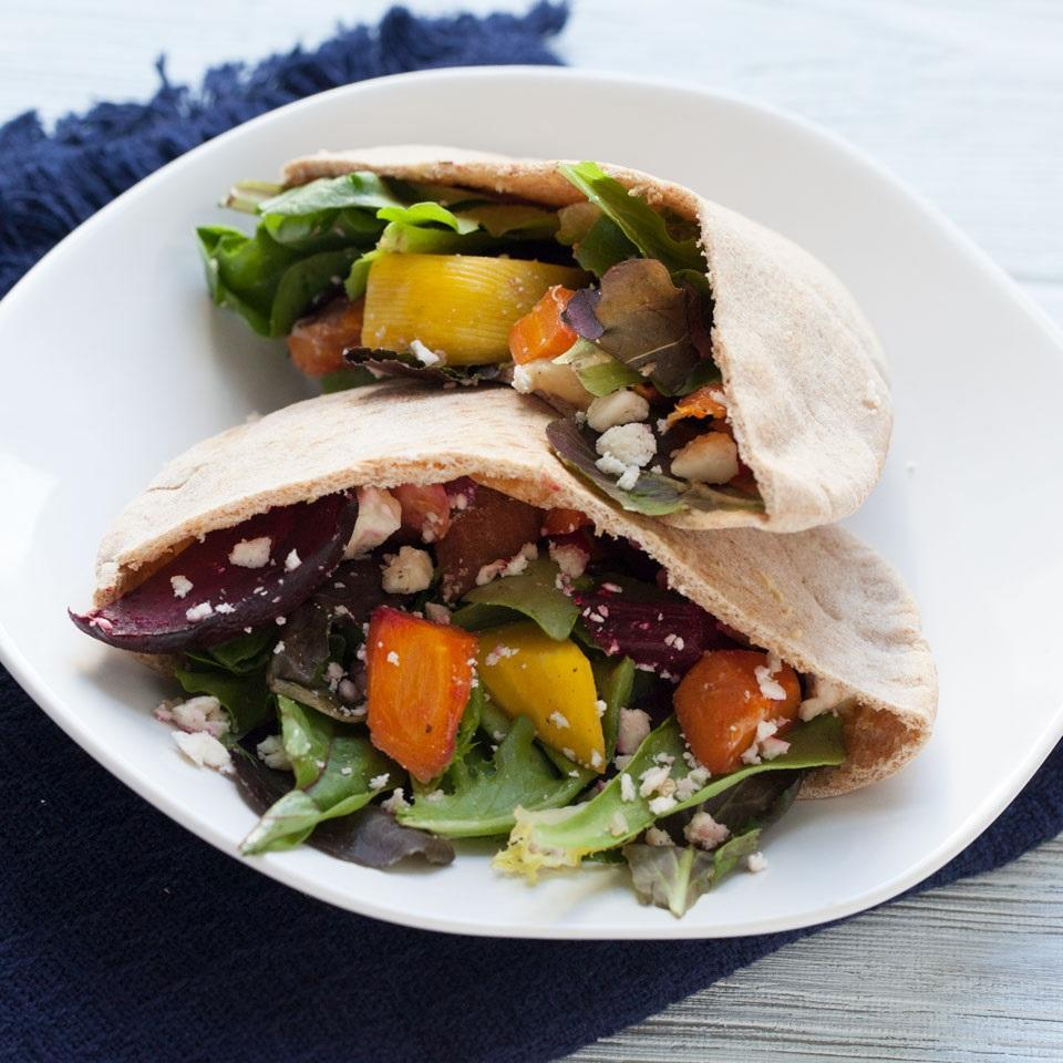 """<p>editerranean flavors and fiber-packed ingredients combine for a satisfying and tasty pita-pocket sandwich. <a href=""""https://www.eatingwell.com/recipe/261292/roasted-veggie-hummus-pita-pockets/"""" rel=""""nofollow noopener"""" target=""""_blank"""" data-ylk=""""slk:View Recipe"""" class=""""link rapid-noclick-resp"""">View Recipe</a></p>"""