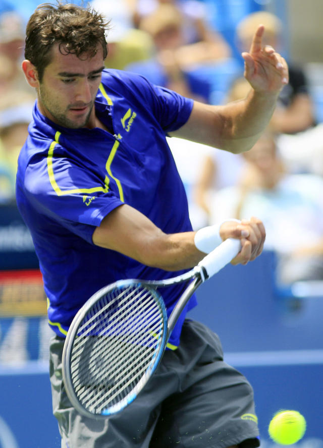 Marin Cilic, from Croatia, hits a forehand shot against Novak Djokovic, from Serbia, during a quarterfinals match at the Western & Southern Open tennis tournament, Friday, Aug. 17, 2012, in Mason, Ohio. Djokovic won 6-3, 6-2. (AP Photo/Al Behrman)
