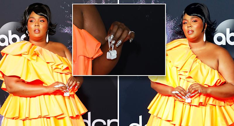 Lizzo's tiny bag already has its own Twitter account. [Photo: Getty]