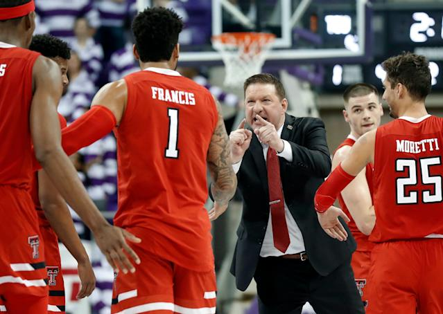 "Texas Tech head coach Chris Beard, center, cheers on Tariq Owens (11), Brandone Francis (1), <a class=""link rapid-noclick-resp"" href=""/ncaab/players/142324/"" data-ylk=""slk:Davide Moretti"">Davide Moretti</a> (25) and <a class=""link rapid-noclick-resp"" href=""/ncaab/players/126545/"" data-ylk=""slk:Matt Mooney"">Matt Mooney</a>, right rear, during a time out late in the second half of an NCAA college basketball game against TCU in Fort Worth, Texas, Saturday, March 2, 2019. (AP Photo/Tony Gutierrez)"