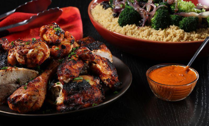 """<p>The smoky flavors from cooking over wood chips complement spicy heat very, very well — as this harissa-marinated chicken recipe demonstrates.</p> <p><a href=""""https://www.thedailymeal.com/best-recipes/harissa-grilled-chicken?referrer=yahoo&category=beauty_food&include_utm=1&utm_medium=referral&utm_source=yahoo&utm_campaign=feed"""" rel=""""nofollow noopener"""" target=""""_blank"""" data-ylk=""""slk:For the Harissa Grilled Chicken recipe, click here."""" class=""""link rapid-noclick-resp"""">For the Harissa Grilled Chicken recipe, click here.</a></p>"""