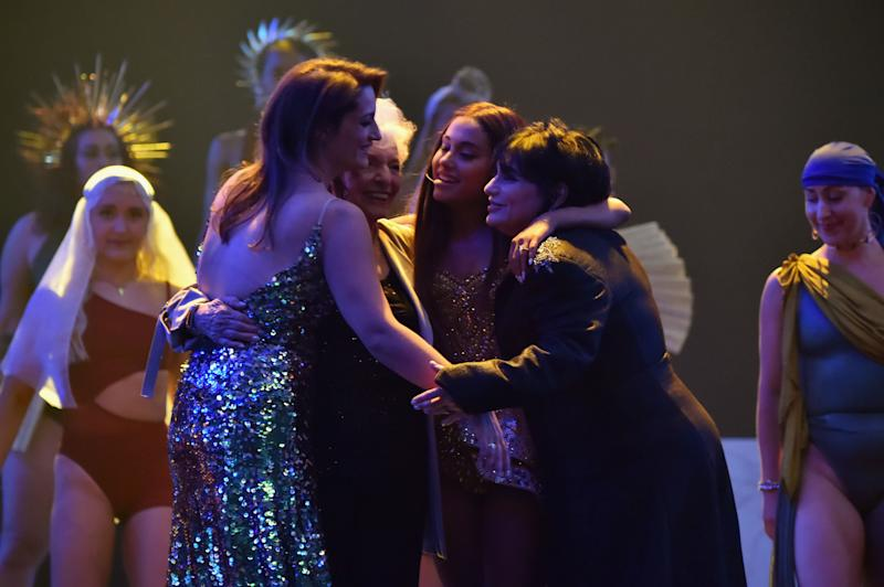 The four hug each other at the end of the performance. (Photo: Kevin Mazur via Getty Images)
