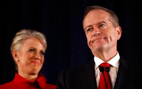 Bill Shorten, seen with his wife Chloe, concedes defeat in Melbourne on Saturday evening - Credit: Ryan Pierse/Getty