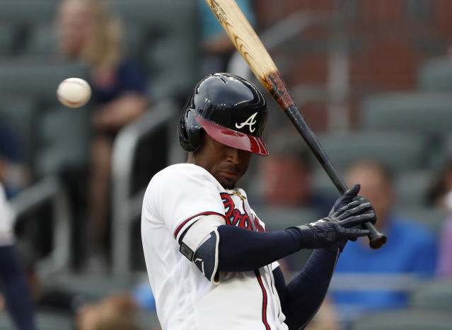 Atlanta Braves' Ozzie Albies (1) avoids being hit by a pitch from Milwaukee Brewers starter Freddy Peralta in the first inning of a baseball game Friday, Aug. 10, 2018, in Atlanta. (AP Photo/John Bazemore)