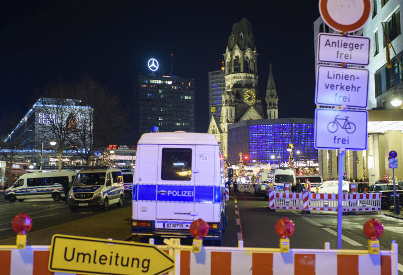 Police cordon off the area of Berlin Christmas Market at the Gedachtniskirche, in Berlin, Saturday, Dec. 21, 2019. (Gregor Fischer/dpa via AP)
