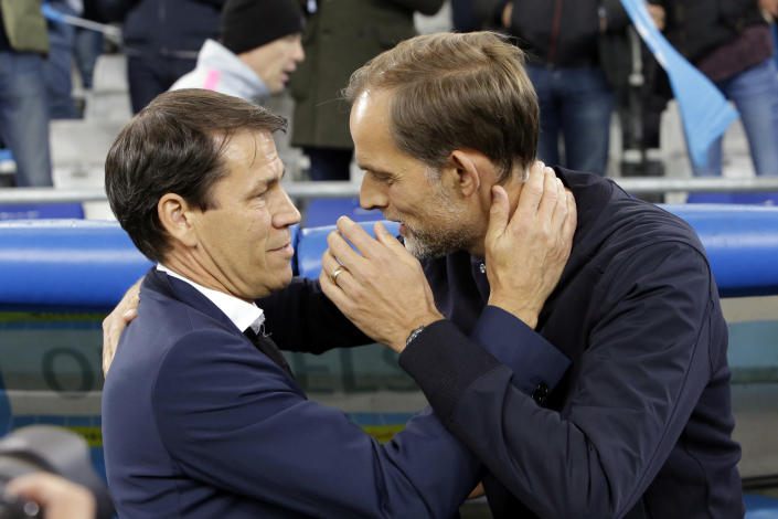 PSG's coach Thomas Tuchel, right, and Marseille's coach Rudi Garcia talk prior to the French League One soccer match between Paris-Saint-Germain and Marseille at the Velodrome Stadium in Marseille, France, Sunday, Oct. 28, 2018. (AP Photo/Claude Paris)