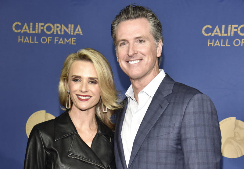 SACRAMENTO, CALIFORNIA - DECEMBER 10: Governor Gavin Newsom (R) and First Partner Jennifer Siebel Newsom arrive during the 13th Annual California Hall of Fame induction ceremony at The California Museum on December 10, 2019 in Sacramento, California. (Photo by Tim Mosenfelder/Getty Images)