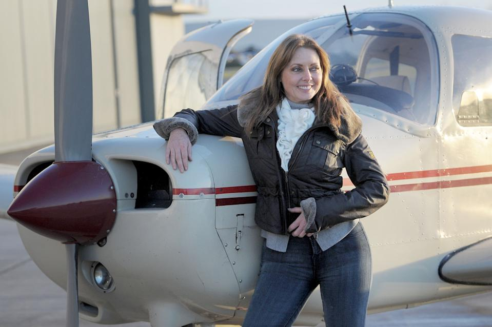 Carol Vorderman at the Staverton Flying School at Gloucester Airport after passing her private pilot's licence (PPL) test.   (Photo by Tim Ireland/PA Images via Getty Images)