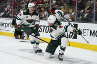 Minnesota Wild left wing Jordan Greenway (18) celebrates after scoring against the Vegas Golden Knights during the first period of an NHL hockey game Monday, May 24, 2021, in Las Vegas. (AP Photo/John Locher)