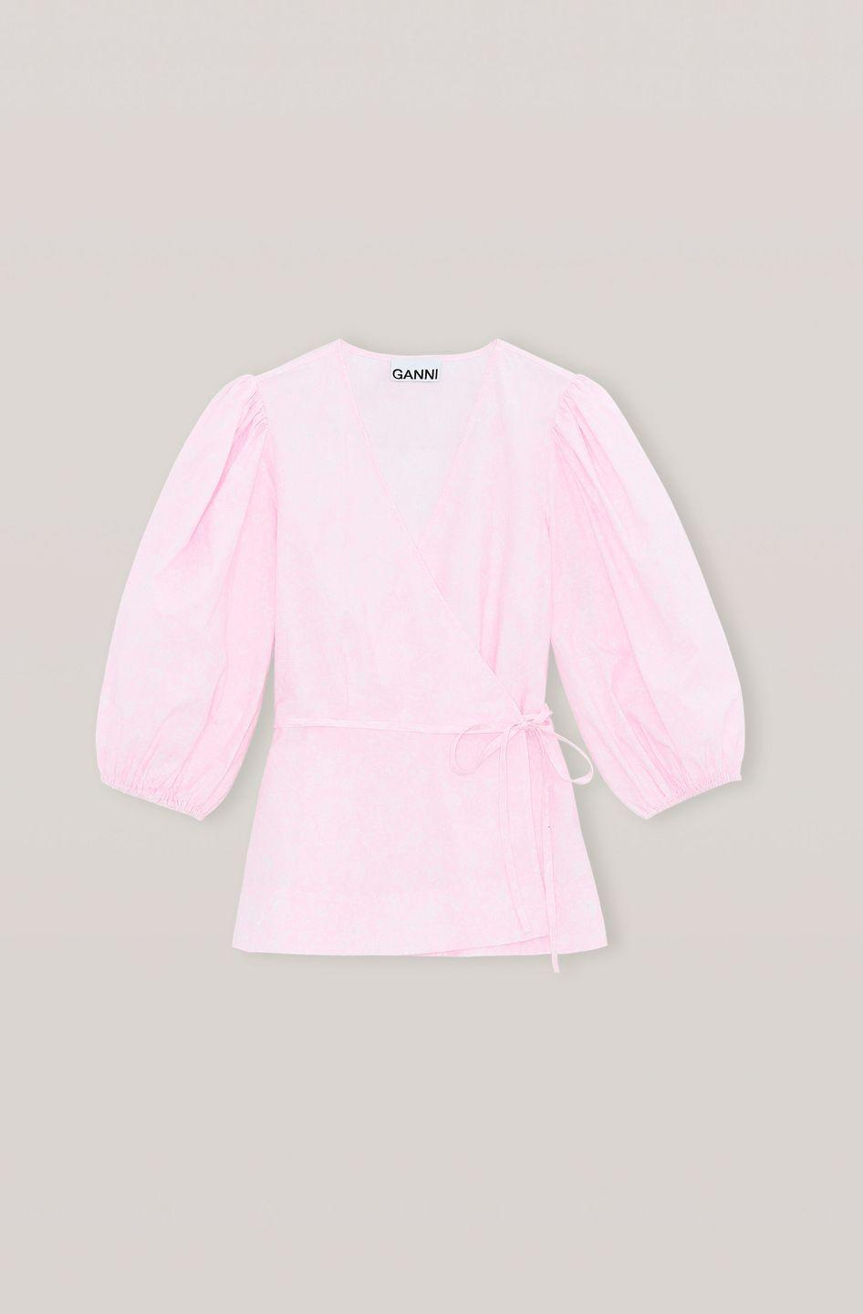 """<p><a class=""""link rapid-noclick-resp"""" href=""""https://go.redirectingat.com?id=127X1599956&url=https%3A%2F%2Fwww.ganni.com%2Fen-gb%2Fprinted-cotton-poplin-wrap-top-F4766.html%3Fdwvar_F4766_color%3DCherry%2BBlossom&sref=https%3A%2F%2Fwww.townandcountrymag.com%2Fuk%2Fstyle%2Fg35350261%2Fvalentines-day-outfits%2F"""" rel=""""nofollow noopener"""" target=""""_blank"""" data-ylk=""""slk:SHOP NOW"""">SHOP NOW</a></p><p>The puff sleeves on this Ganni blouse bring a touch of feminine playfulness to Valentine's Day.</p><p>Cotton poplin wrap top, £73, Ganni.</p>"""