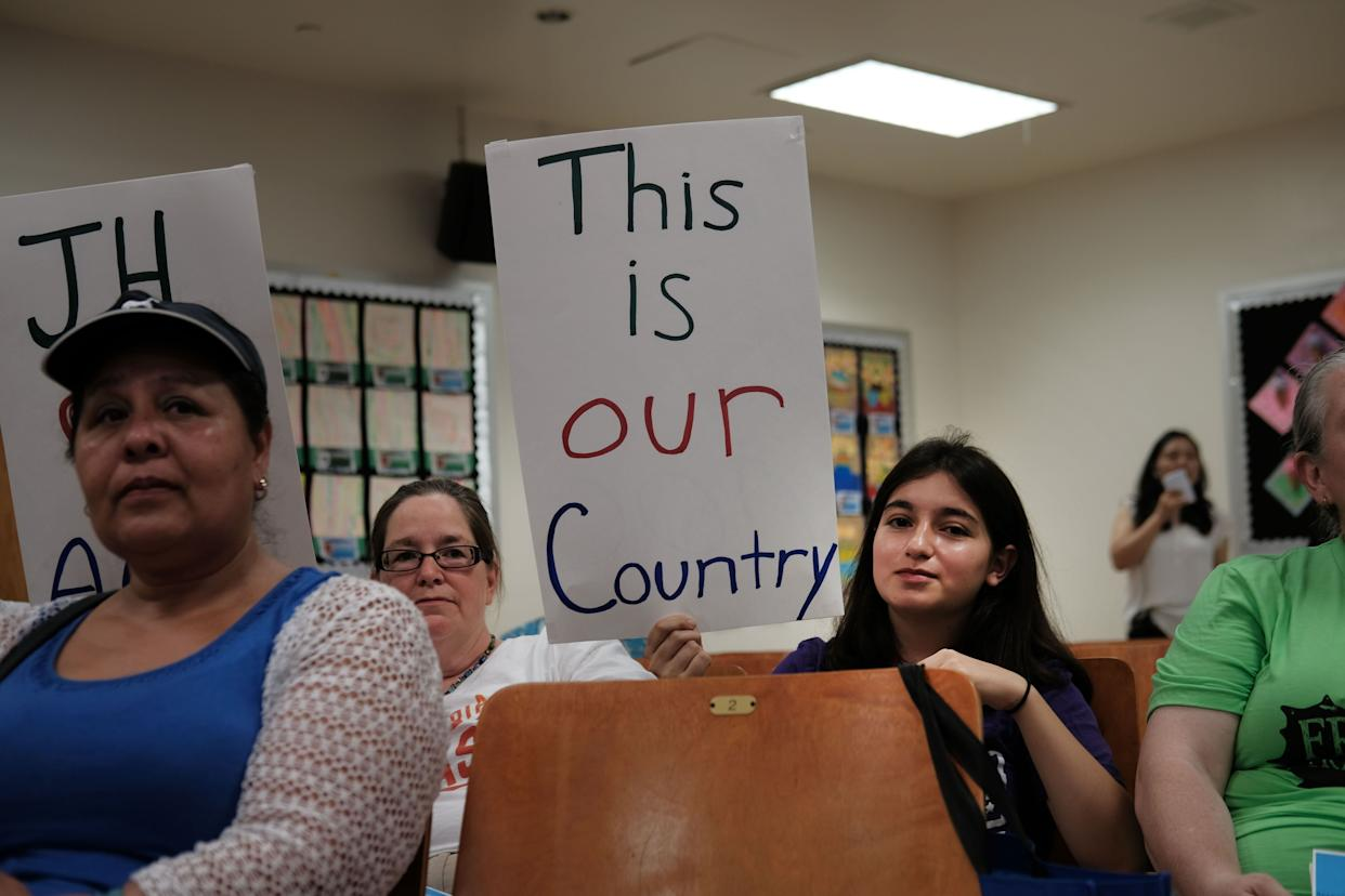 Some of Ocasio-Cortez's diverse constituents brought homemade signs to an immigration town hall on Saturday. (Photo: Spencer Platt/Getty Images)