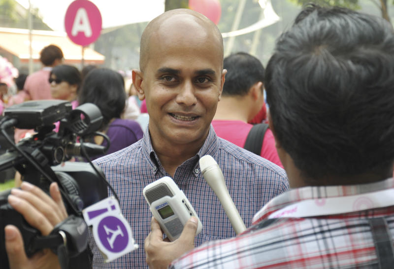 In this Saturday, June 29, 2013 photo released by Pink Dot SG rally organizers, Singapore's first openly gay politician, Vincent Wijeysingha, a member of the opposition Singapore Democratic Party, speaks to reporters at the annual Pink Dot SG rally in support of gay rights in Singapore's Hong Lim Park. Wijeysingha recently confirmed that he is gay and said he believes Singapore's government will someday be forced to abolish a law that criminalizes consensual sex between men. (AP Photo/Pink Dot SG)