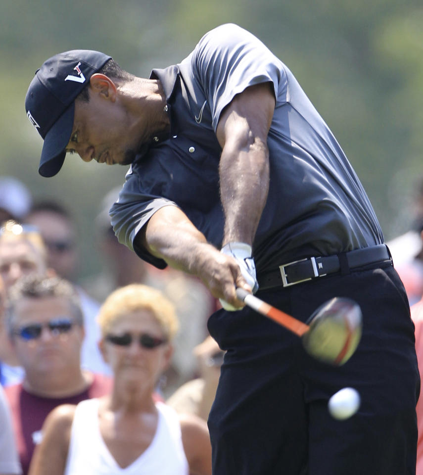 Tiger Woods tees off on the ninth hole during the second round of the Bridgestone Invitational golf tournament at Firestone Country Club, Friday, Aug. 3, 2012, in Akron, Ohio. Woods finished two-over par after the second round. (AP Photo/Tony Dejak)
