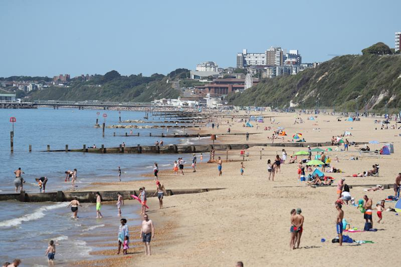 People enjoy the hot weather between Bournemouth beach and Boscombe beach in Dorset, following the introduction of measures to bring the country out of lockdown.