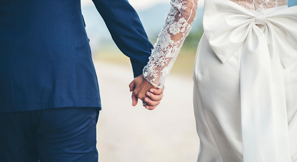 Wedding trainers are a great alternative to wear instead of stilettos on your wedding day [Photo: Getty]
