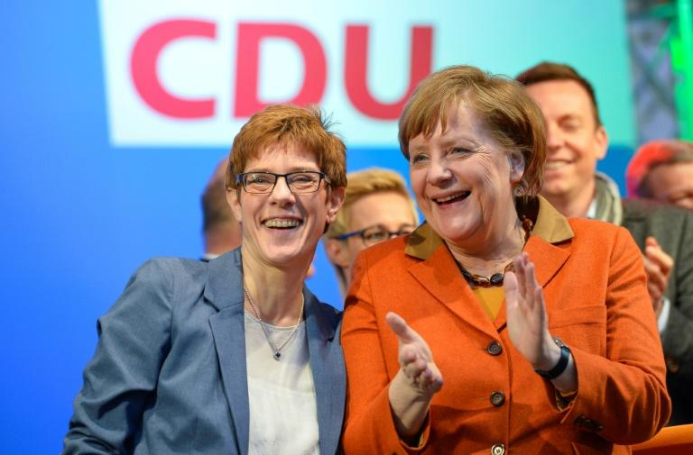 Saarland's CDU prime minister and candidate Annegret Kramp-Karrenbauer (C) and Angela Merkel, German Chancellor and Chairwoman of the CDU (C) greet the public during a rally ahead of the Saarland regional elections March 23, 2017