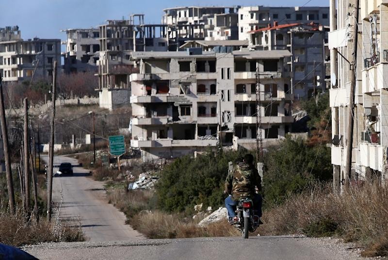 Syrian troops ride a motorcycle in Salma, in the northwestern province of Latakia (AFP Photo/Youssef Karwashan)