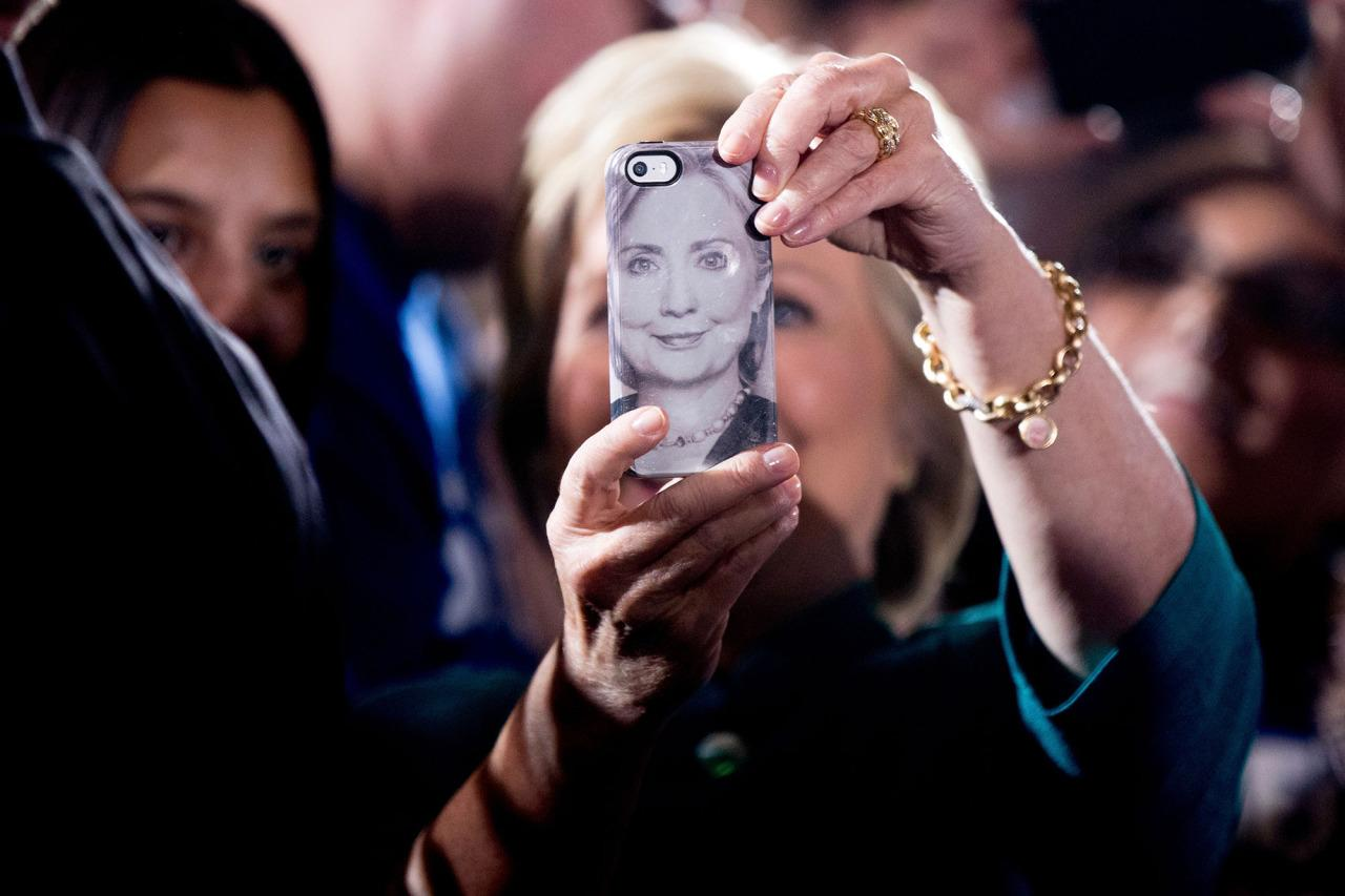 <p>A photograph of Democratic presidential candidate Hillary Clinton is displayed on a smartphone as she takes a selfie with a supporter after speaking at a rally at the Culinary Academy of Las Vegas, July 19, 2016. (Photo: Andrew Harnik/AP)</p>