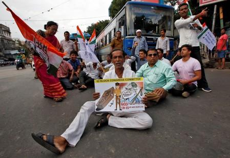Supporters of India's main opposition Congress party block a road during a protest against the arrest of former Finance Minister Chidambaram, in Kolkata