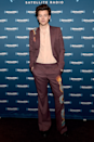 <p>Only Harry could pull off an aubergine suit with a dragon on the pant leg, paired with a pale salmon shirt unbuttoned almost to his navel. I think I need another break...BRB.</p>